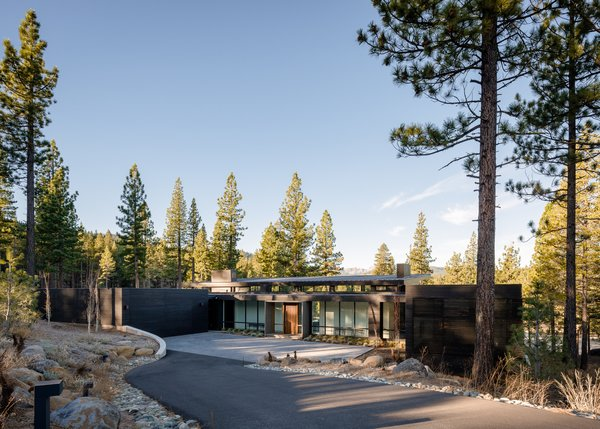 Modern home with outdoor, front yard, trees, hardscapes, walkways, boulders, concrete patio, porch, deck, gardens, and metal patio, porch, deck. Entry Driveway Approach  Photo 3 of Martis Camp Residence 1