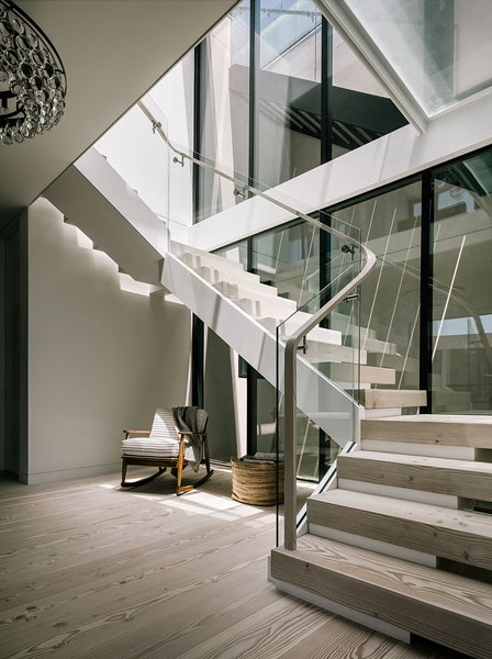 Modern home with light hardwood floor, staircase, wood tread, and wood railing. Entry Stair Photo 15 of Butterfly House