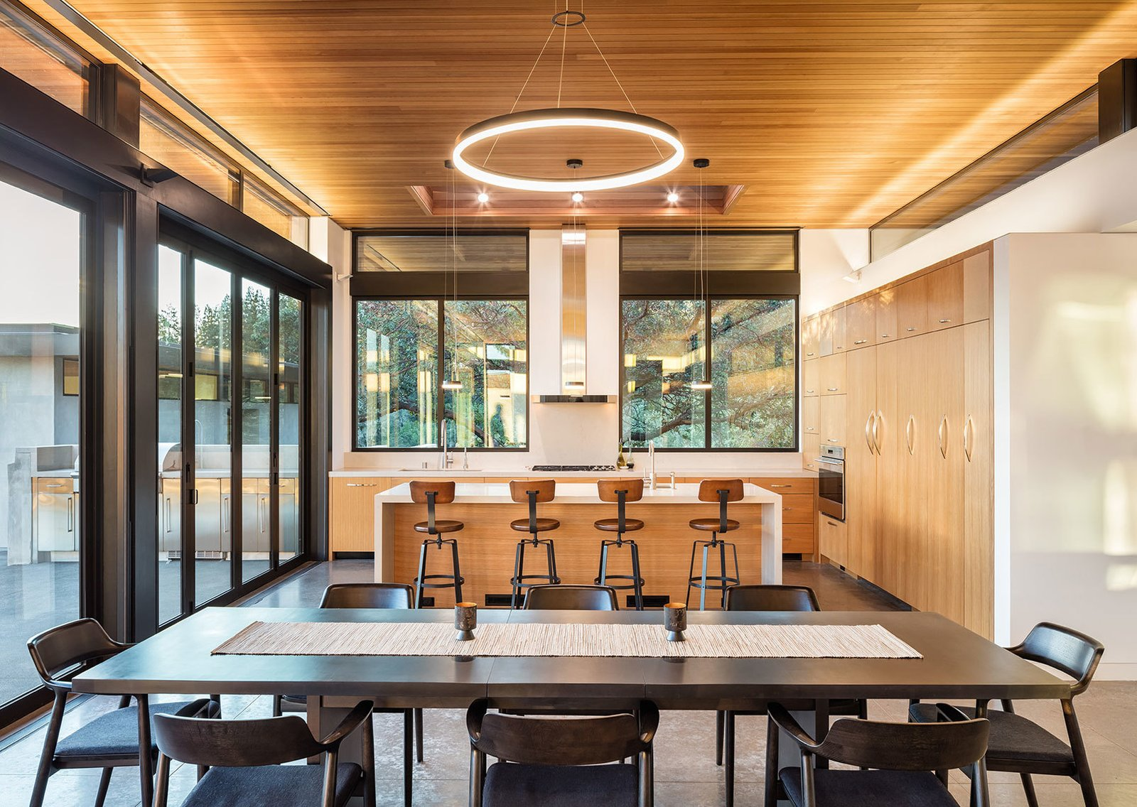 Tagged: Table, Chair, Ceiling Lighting, Stools, Recessed Lighting, Kitchen, Concrete Floor, Wood Cabinet, Engineered Quartz Counter, Refrigerator, Wall Oven, Cooktops, Dishwasher, Undermount Sink, and Range Hood.  Dry Creek by John Maniscalco Architecture