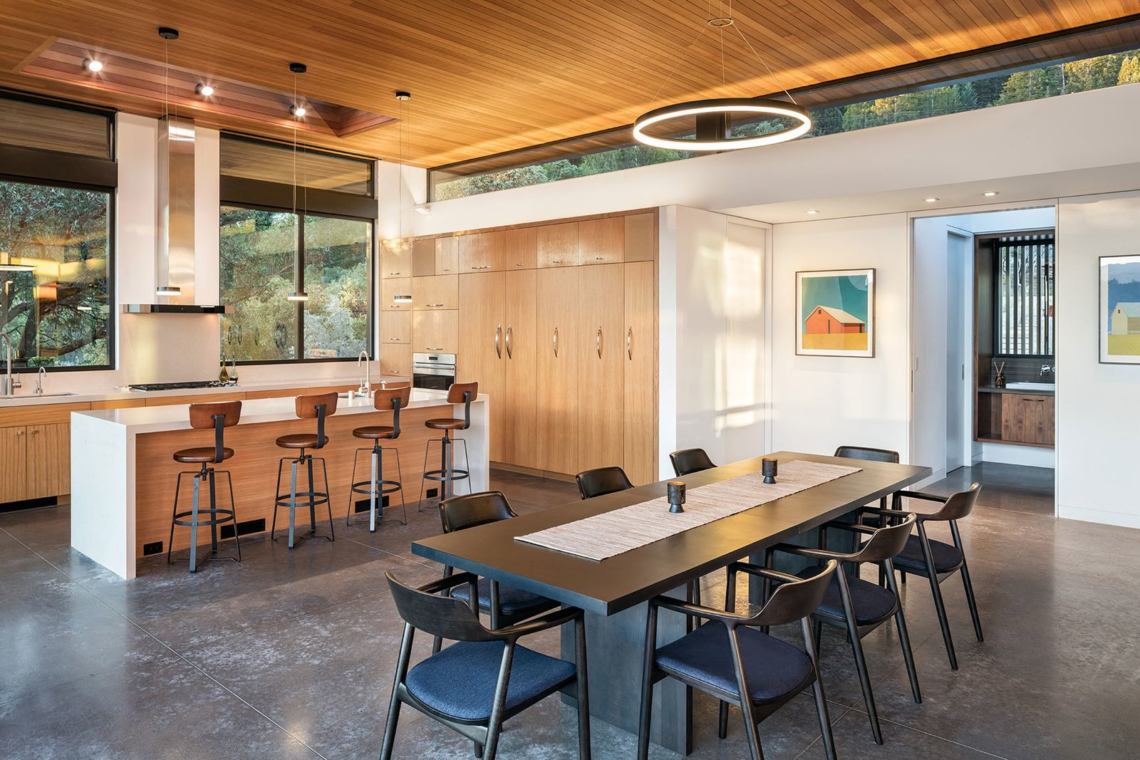 Tagged: Kitchen, Engineered Quartz Counter, Wood Cabinet, Concrete Floor, Ceiling Lighting, Recessed Lighting, Refrigerator, Wall Oven, Range, Undermount Sink, Range Hood, and Dishwasher.  Dry Creek by John Maniscalco Architecture