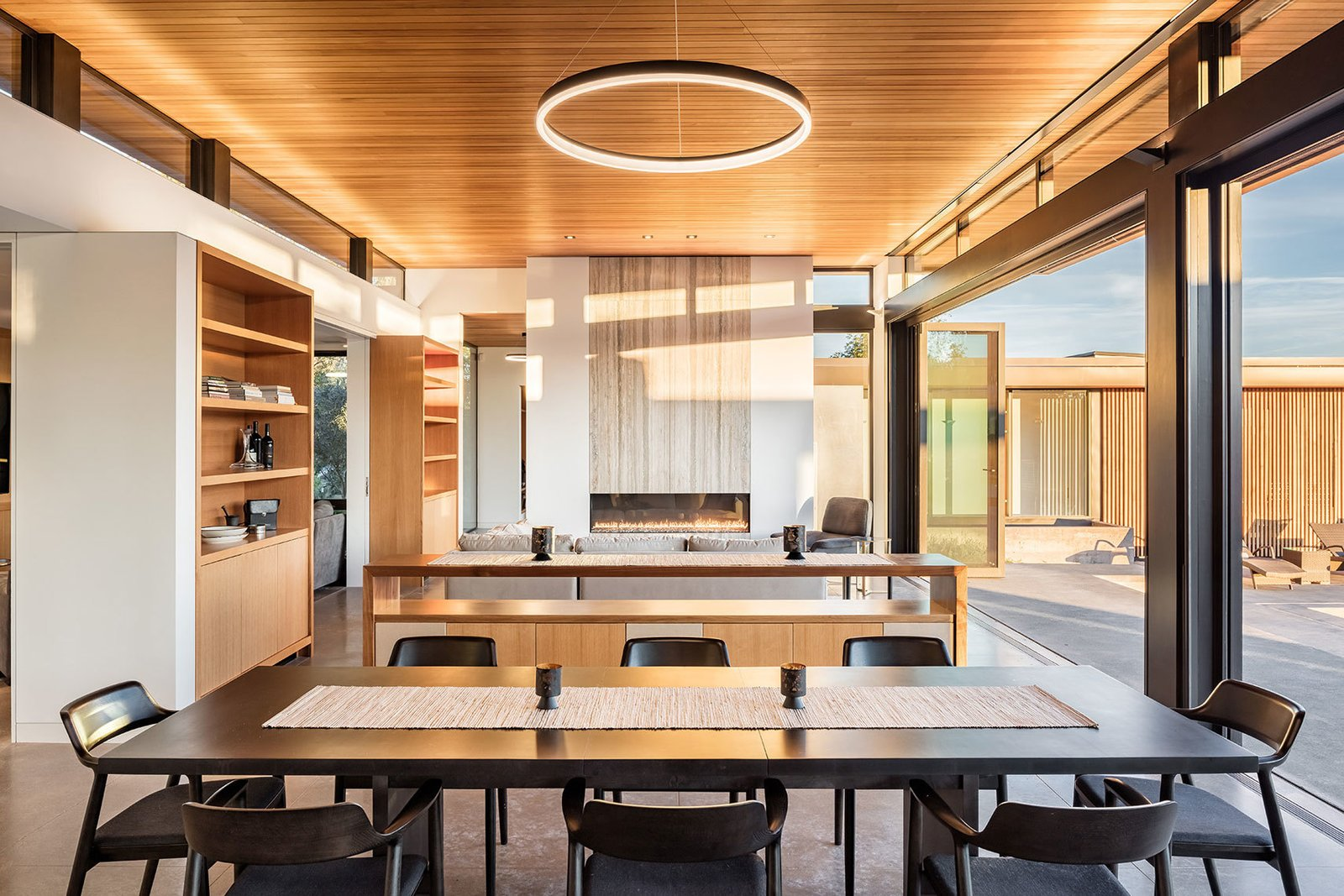 Tagged: Dining Room, Table, Chair, Storage, Ceiling Lighting, Recessed Lighting, Concrete Floor, Gas Burning Fireplace, and Ribbon Fireplace.  Dry Creek by John Maniscalco Architecture