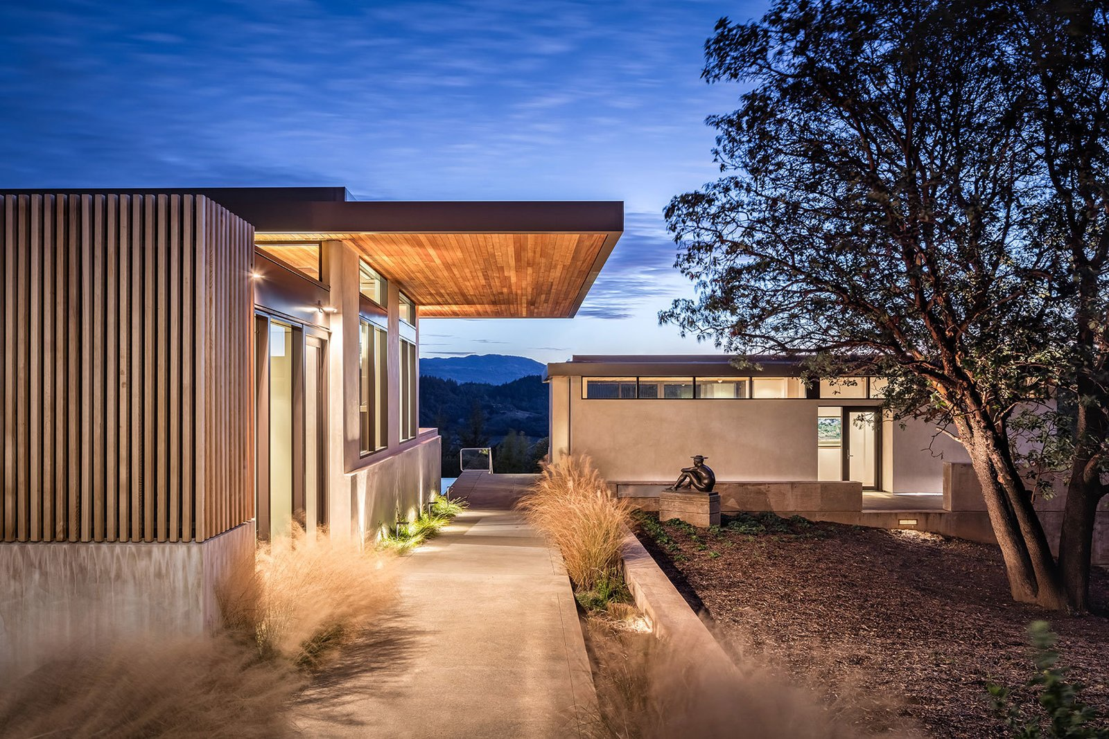 Tagged: Outdoor, Front Yard, Trees, Grass, Walkways, Shrubs, and Landscape Lighting.  Dry Creek by John Maniscalco Architecture