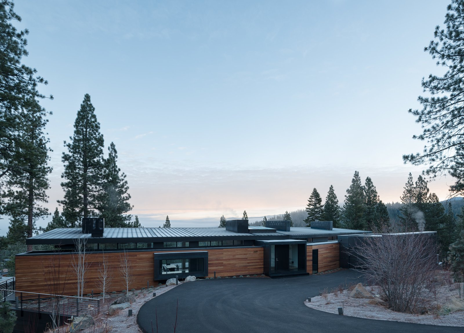 Tagged: Outdoor, Front Yard, Trees, Shrubs, and Boulders.  Martis Camp Residence 2 by John Maniscalco Architecture