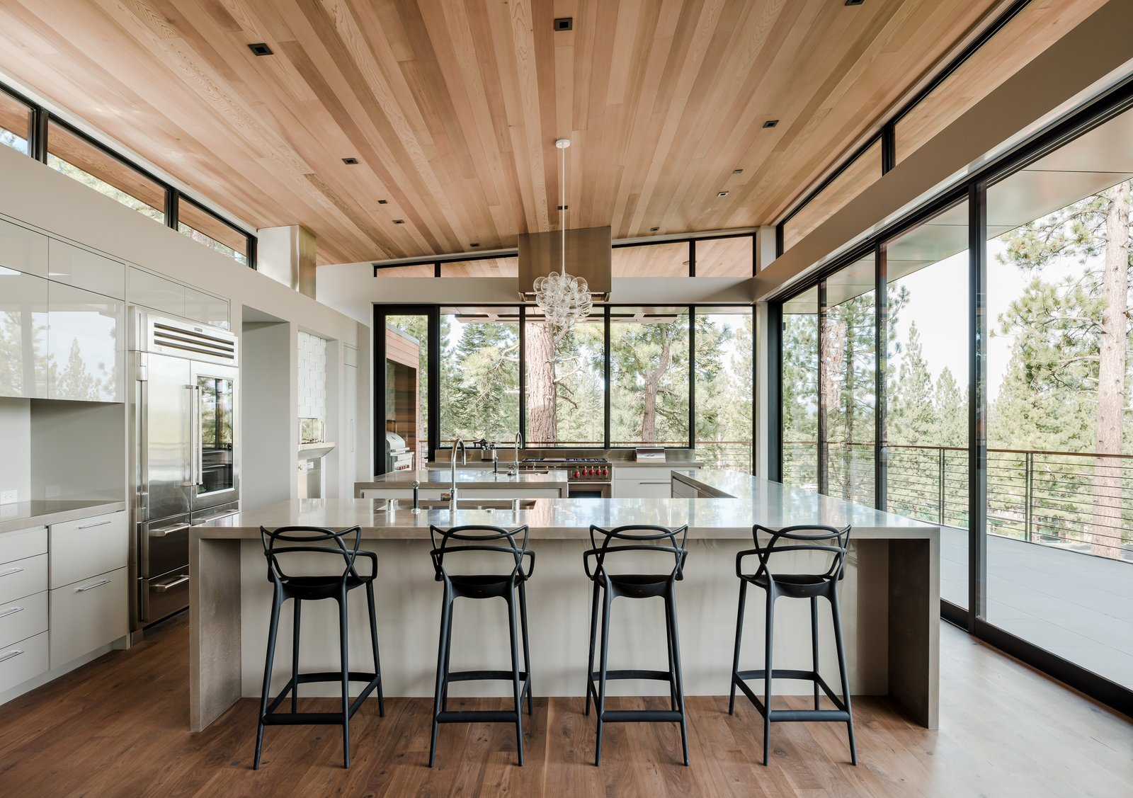 Tagged: Kitchen, Engineered Quartz Counter, White Cabinet, Medium Hardwood Floor, Ceiling Lighting, Recessed Lighting, Refrigerator, Accent Lighting, Wall Oven, Range, and Undermount Sink.  Martis Camp Residence 2 by John Maniscalco Architecture