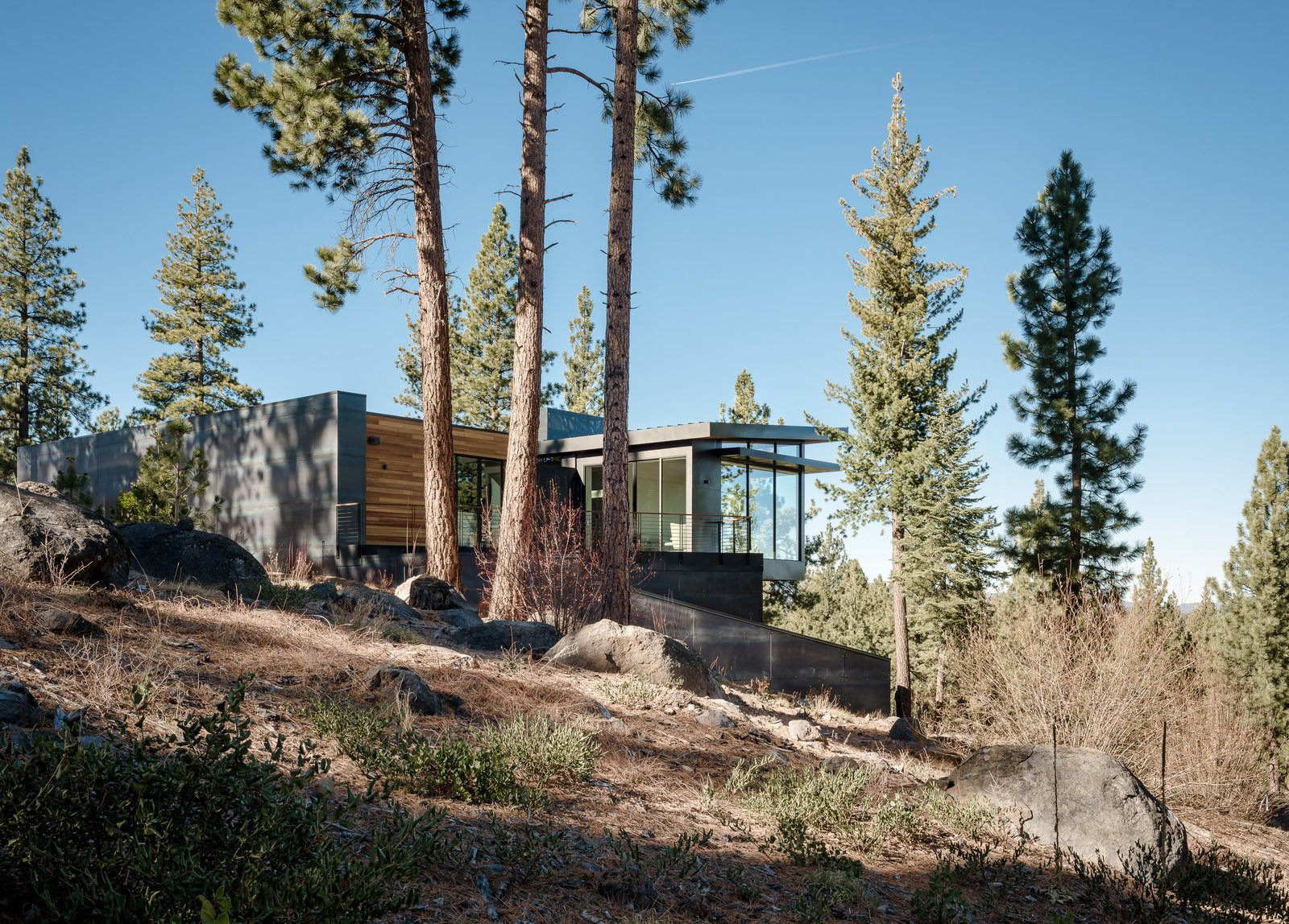 Tagged: Outdoor, Trees, Shrubs, Side Yard, Flowers, and Boulders.  Martis Camp Residence 2 by John Maniscalco Architecture