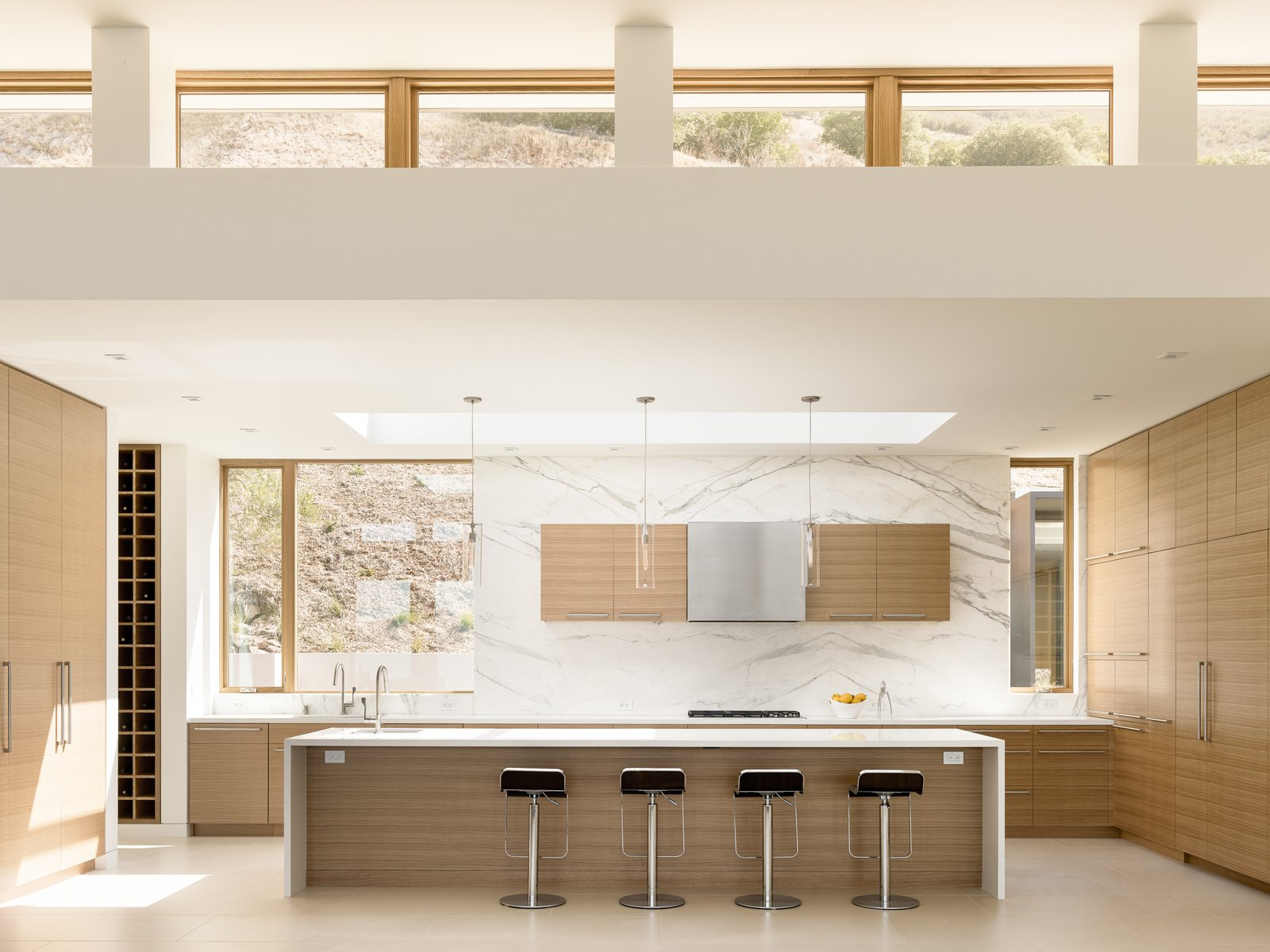 Tagged: Kitchen, Engineered Quartz Counter, Porcelain Tile Floor, Wood Cabinet, Ceiling Lighting, Marble Backsplashe, Pendant Lighting, Recessed Lighting, Refrigerator, Cooktops, Dishwasher, Wall Oven, Wine Cooler, Range Hood, and Undermount Sink.  Silverado by John Maniscalco Architecture