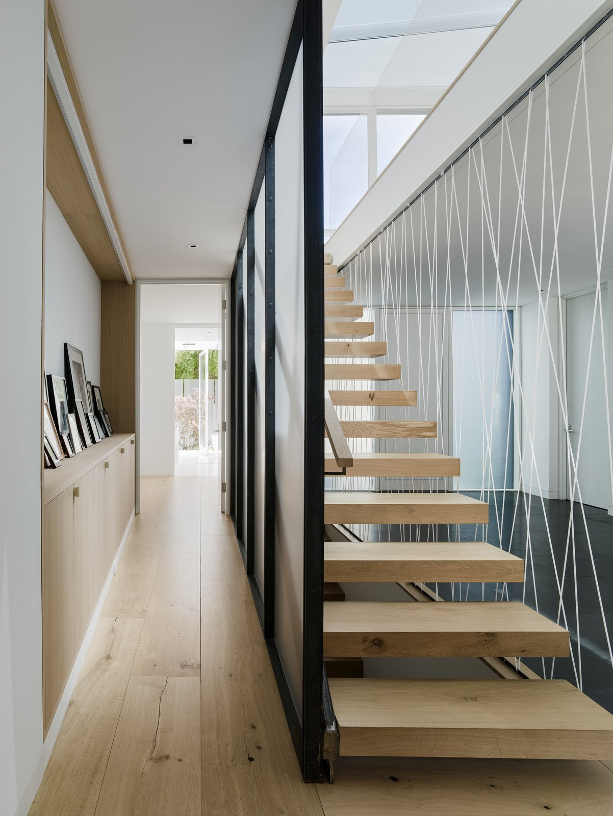 Tagged: Medium Hardwood Floor, Staircase, Cable Railing, and Wood Tread.  Spruce by John Maniscalco Architecture