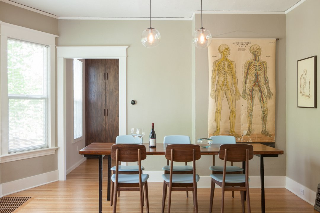 The kitchen aesthetic is a counterpoint to the 1909 home. But matched oak flooring and a long-lined, elegant cabinetry scheme seek to harmonize old + new.