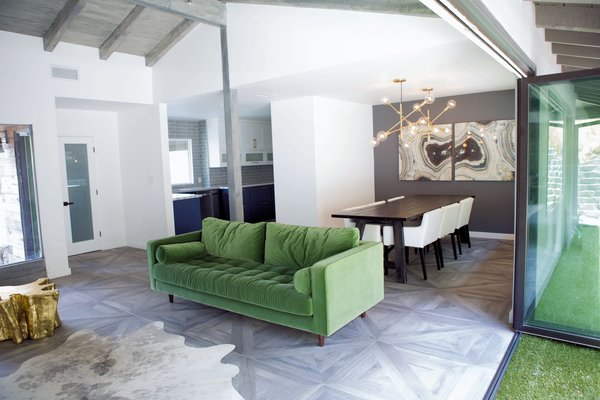 Modern home with dining room. Green, navy, gold, and gray are the foundational colors for this modern farmhouse, carried throughout the open floorplan. Photo 8 of Diablo Ranch