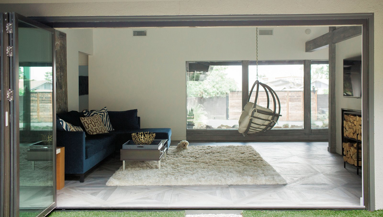 NanaWall bifold glass doors open to the living room and den, allowing views from the back lawn to the front courtyard. Tagged: Living, Chair, Sectional, End Tables, Coffee Tables, Console Tables, and Porcelain Tile.  Best Living Console Tables End Tables Photos from Diablo Ranch