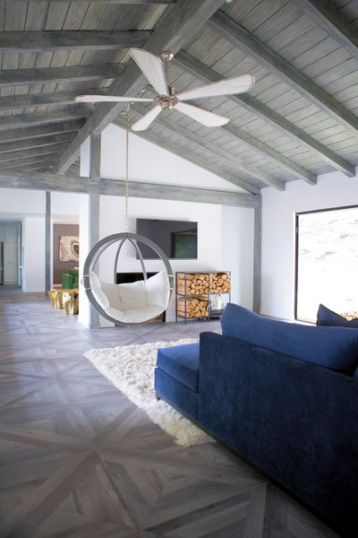 A swing hanging from the rafters isn't standard farmhouse fare, but quickly became the favorite lounge spot for family and visitors alike.  Like many of the lighting and plumbing fixtures, the ceiling fan was recycled from Jennifer's last home.