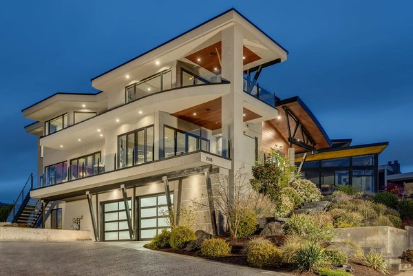 Modern home with outdoor. Architectural masterpiece perched above Lake Washington maximizes breathtaking Lake, City and Mountain views! This builders own home was designed to be one of a kind with unique lines, exquisite finishes, and expansive open spaces that effortlessly flow to the covered outdoor living spaces and blur the difference between outdoor and indoor living. Additional Dwelling Unit apartment with separate entrance offers flexibility for a number of uses. Just steps to the Lake and blocks to Downtown Kirkland!  See more: www.DowntownKirklandModern.com Photo  of Downtown Kirkland Modern