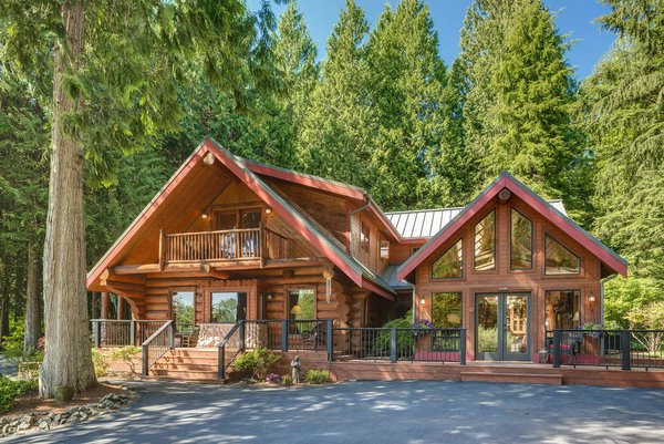 Modern home with outdoor, front yard, trees, shrubs, grass, large patio, porch, deck, and wood patio, porch, deck. www.SnohomishEquestrianLodge.com Photo  of Snohomish Equestrian Lodge