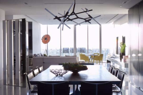 Modern home with dining room, table, chair, lamps, ceiling lighting, and dark hardwood floor. Dining Room with a view Photo  of Oceana LP