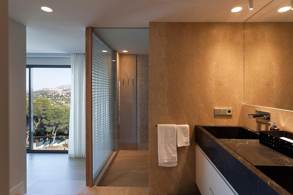 Interior view of the restroom with subtle yellow lighting. Photo 5 of Casa El Bosque modern home