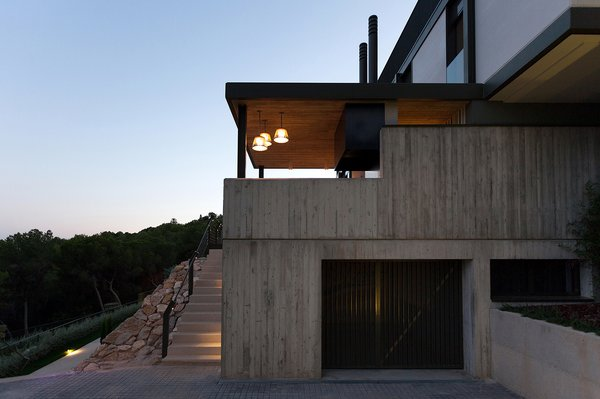 exterior view in the evening. use of stone in the exterior Photo 10 of Casa El Bosque modern home