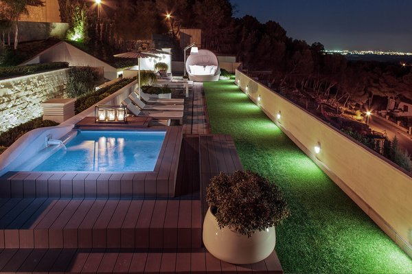Modern home with outdoor. Pool deck area at night Photo  of Casa Klamar