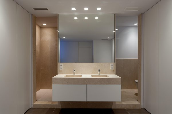 Modern home with bath room, granite counter, ceramic tile floor, ceiling lighting, and drop in sink. Restroom Photo 8 of Casa Forment