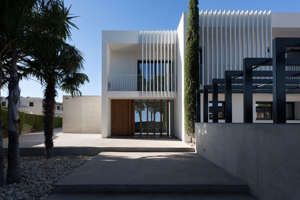 Modern home with outdoor. Front Elevation Photo 4 of Casa Forment