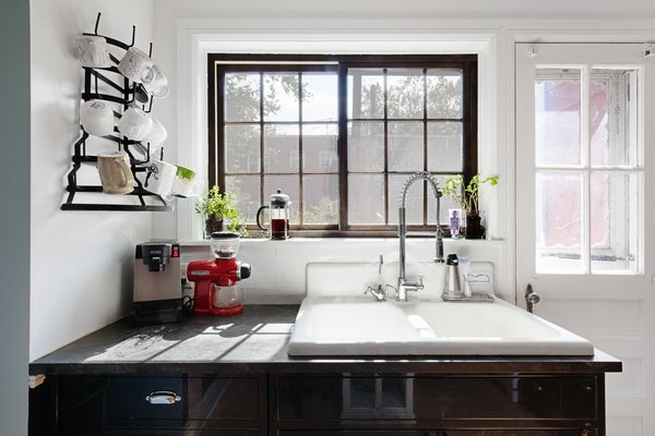 Modern home with kitchen. Photo 18 of Designer's Tudor Townhouse (SWEETEN project, designed by Meredith Lorenzen)