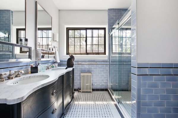 Modern home with bath room, marble counter, full shower, ceramic tile floor, drop in sink, enclosed shower, wall lighting, and glass tile wall. Photo 7 of Designer's Tudor Townhouse (SWEETEN project, designed by Meredith Lorenzen)