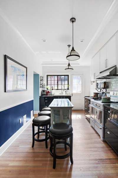 Modern home with kitchen. Photo 17 of Designer's Tudor Townhouse (SWEETEN project, designed by Meredith Lorenzen)