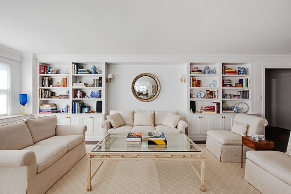 Modern home with living room, bookcase, sofa, coffee tables, and chair. Photo 2 of AN ART-FILLED APARTMENT RENOVATION 40 YEARS IN THE MAKING!
