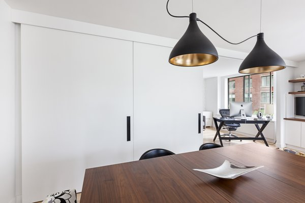 Modern home with dining room. Photo 11 of AFTER A CLOSE CALL, A DREAM APARTMENT COMES TRUE (Sweeten Project)