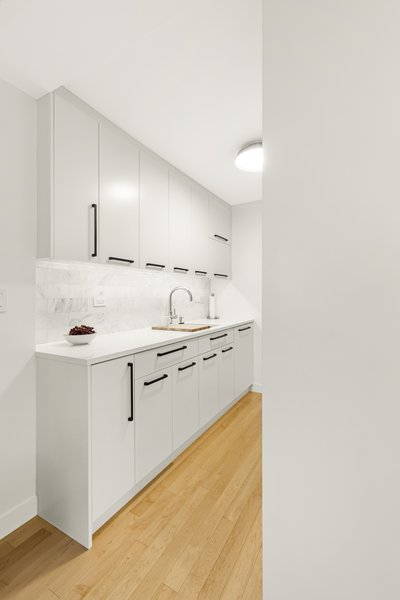 Modern home with kitchen. Photo 2 of AFTER A CLOSE CALL, A DREAM APARTMENT COMES TRUE (Sweeten Project)