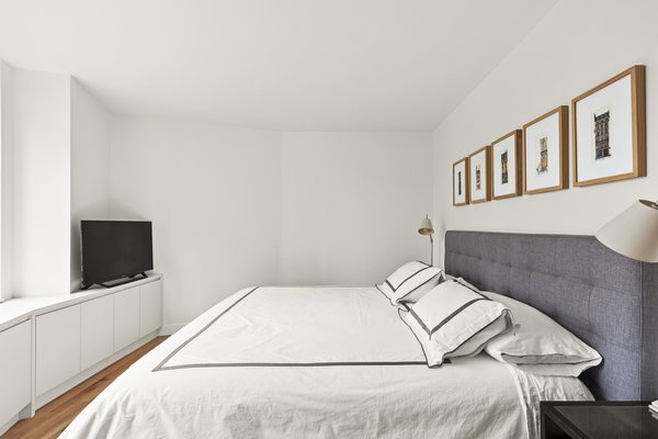 Modern home with bedroom. Photo 7 of AFTER A CLOSE CALL, A DREAM APARTMENT COMES TRUE (Sweeten Project)