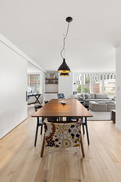Modern home with dining room. Photo 15 of AFTER A CLOSE CALL, A DREAM APARTMENT COMES TRUE (Sweeten Project)