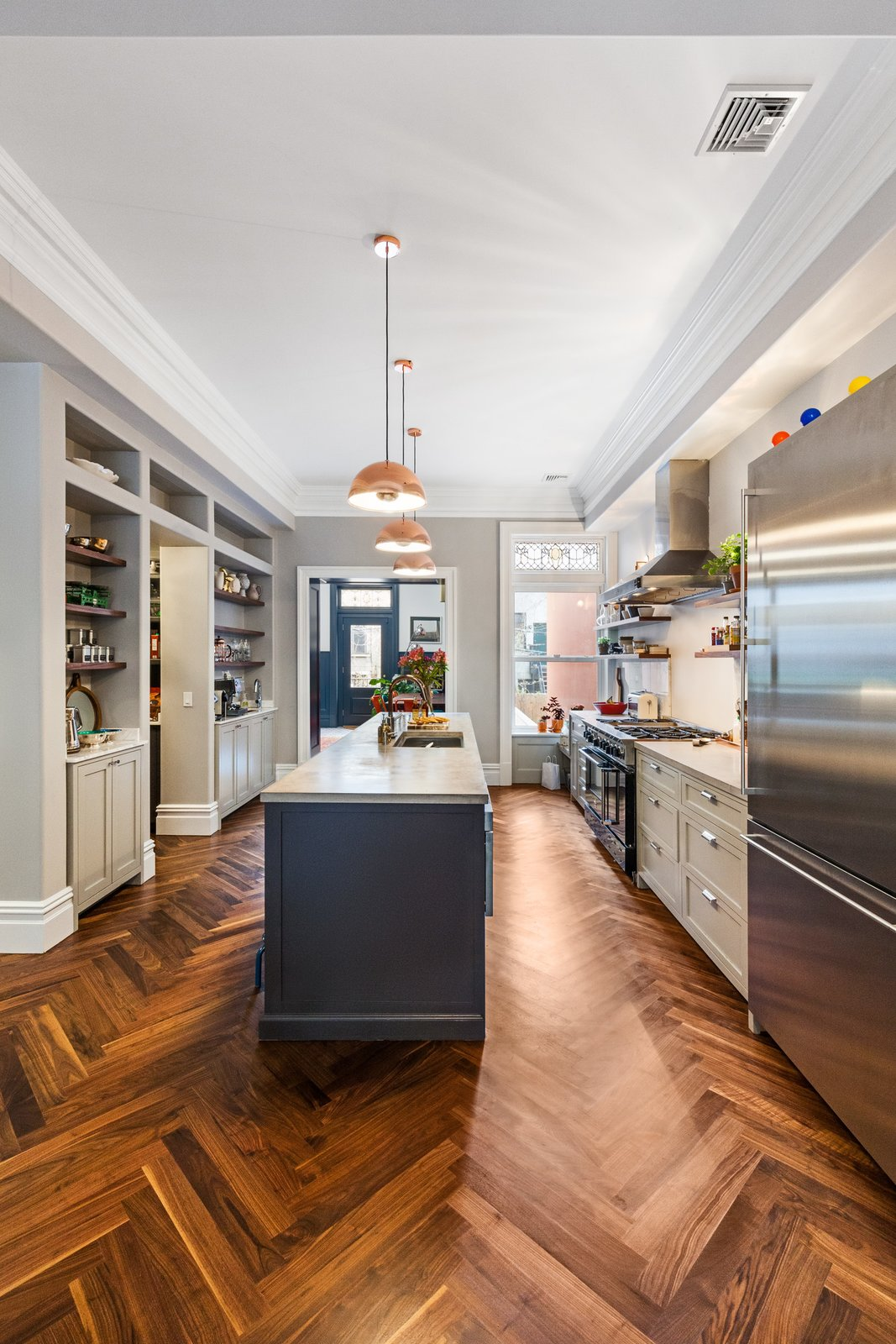 Tagged: Kitchen and Medium Hardwood Floor.  A LONG TOWNHOUSE SETS THE RIGHT FLOW FOR MODERN LIVING (PART 2, SWEETEN project) by Photo by Pixy