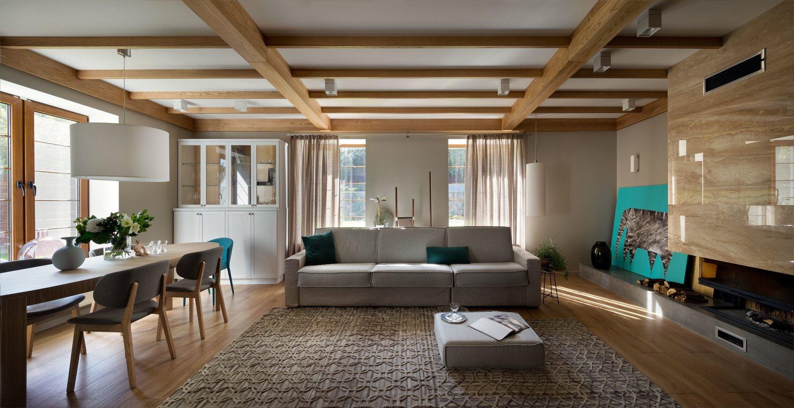 Tagged: Living Room, Sofa, Coffee Tables, Wall Lighting, Pendant Lighting, and Medium Hardwood Floor.  House Lightray by Anna Pahomova