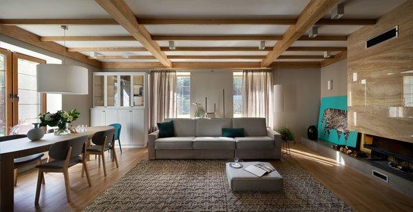 Modern home with living room, sofa, coffee tables, wall lighting, pendant lighting, and medium hardwood floor. Photo 3 of House Lightray
