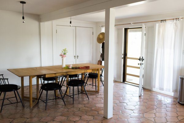 Modern home with kitchen, ceramic tile floor, and pendant lighting. eat-in kitchen; drapery fashioned of queen-size percale sheets, custom copper tube rod Photo 9 of PILGRIM HOUSE