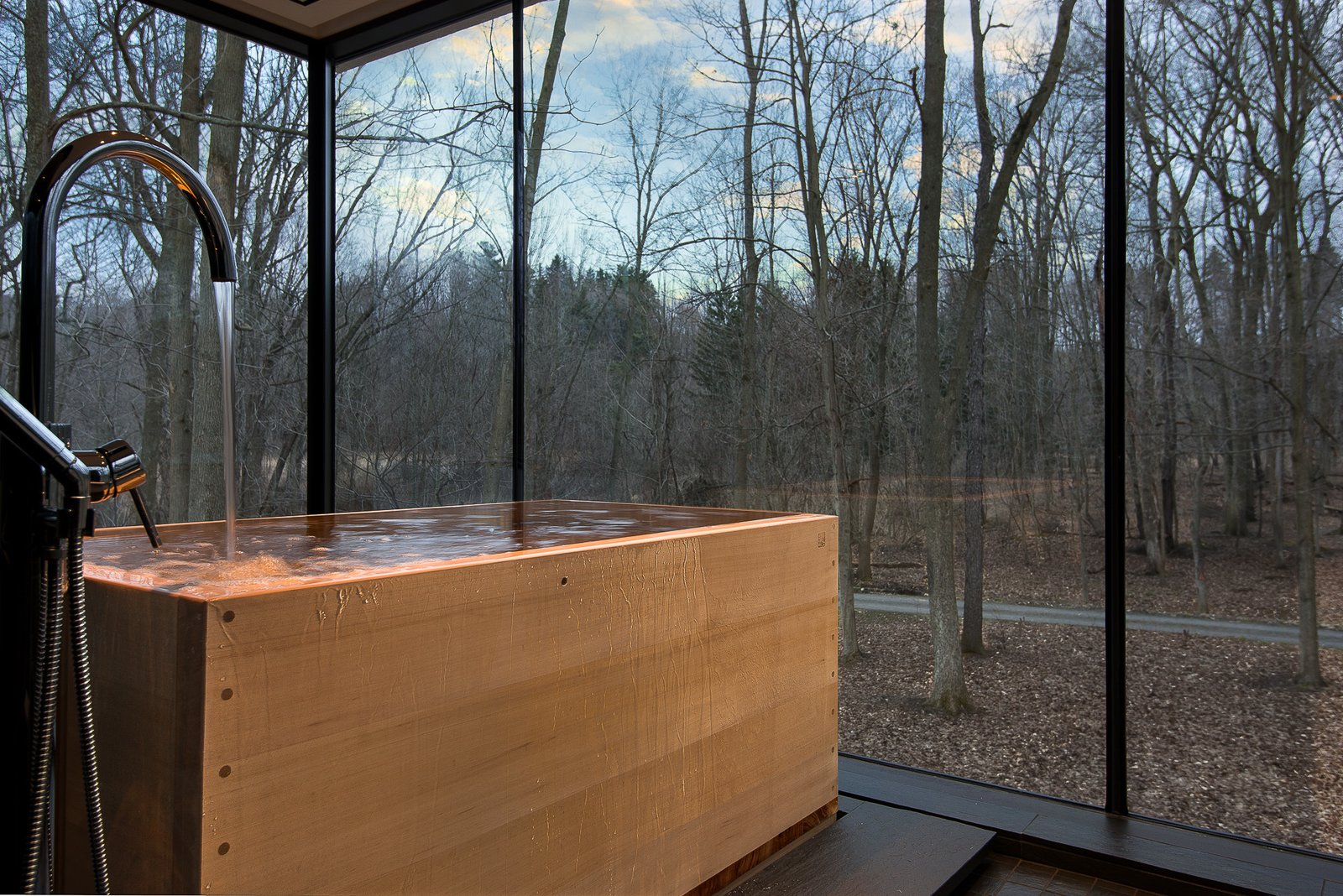 Hinoki tub with floor drain Tagged: Bath Room, Slate Floor, Soaking Tub, and Freestanding Tub.  House in the Woods by Kim Smith