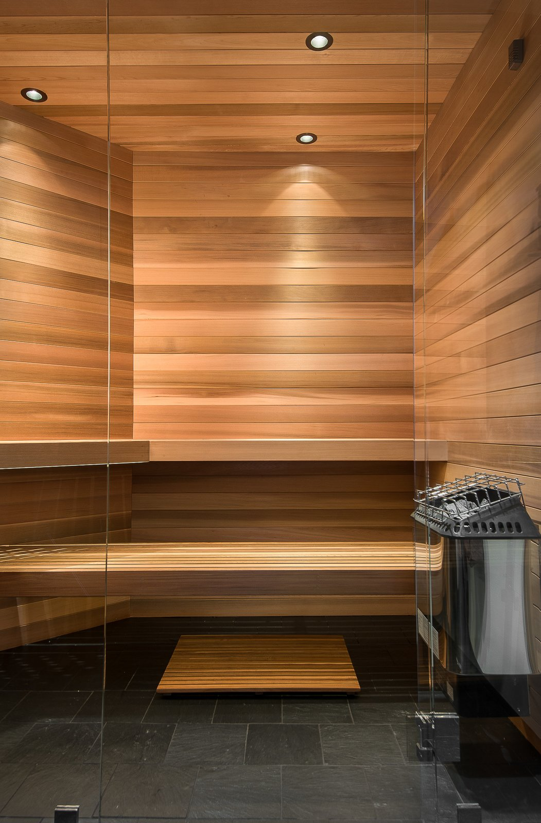 Sauna Tagged: Bath Room, Slate Floor, and Ceiling Lighting.  House in the Woods by Kim Smith