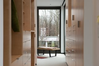 10 Modern Walk-In Closets - Photo 7 of 10 - This residence fuses modern and traditional Japanese design. The large window draws the outdoors in, and opens up the walk-in closet.