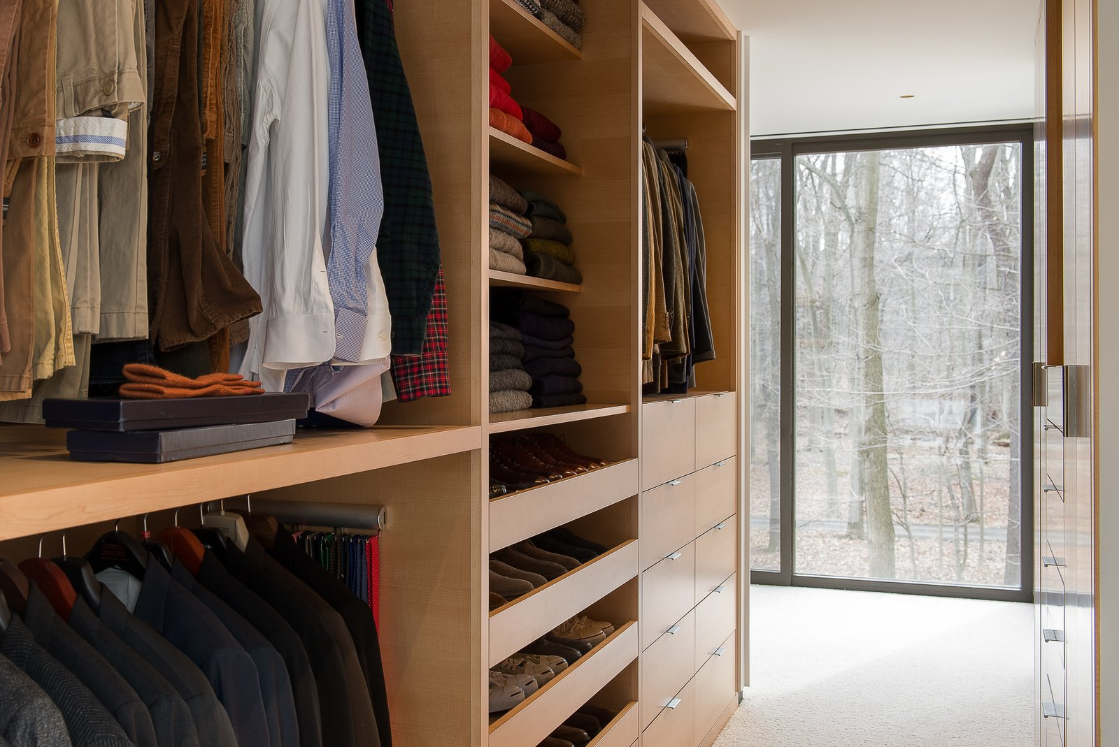 Custom cabinetry, open walk-in Tagged: Storage Room and Closet Storage Type. House in the Woods by Kim Smith