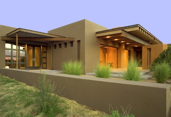 Modern home with outdoor, desert, shrubs, large patio, porch, deck, back yard, and concrete patio, porch, deck. The contemporary home has over 766 square feet of portal space offering exceptional indoor outdoor living in Santa Fe Photo 11 of Santa Fe Contemporary