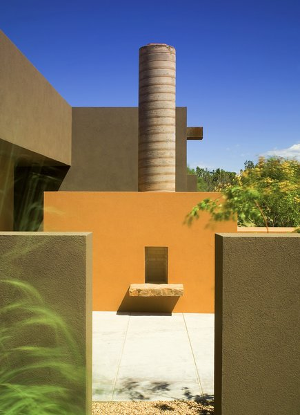 Modern home with outdoor, trees, desert, front yard, shrubs, and concrete patio, porch, deck. The outdoor fire place is an extension of the luxury kitchen, taking advantage of the clear blue New Mexico skies Photo 13 of Santa Fe Contemporary