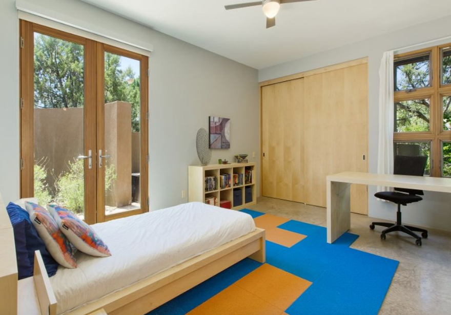 Each guest room has its own courtyard and views of the Jemez Mountains Tagged: Kids, Bed, Bedroom, Bookcase, Chair, Boy, Desk, Concrete, and Teen.  Best Kids Desk Concrete Photos from Santa Fe Contemporary