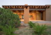 Modern home with Outdoor, Shrubs, Back Yard, Desert, Trees, Hardscapes, Concrete Patio, Porch, Deck, and Boulders. The backyard includes an ironwork feature which catches the rainwater from the roof to create a waterfall. Photo 4 of Santa Fe Contemporary