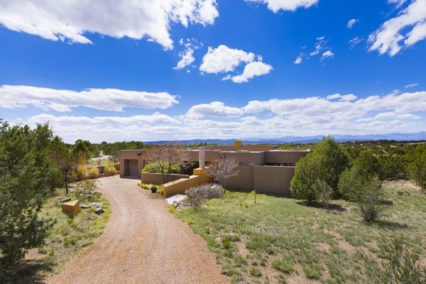 The contemporary High Desert residence is at the end of a cul-de-sac which backs up to a greenbelt offering privacy and stunning views of the Santa Fe mountains. Photo  of Santa Fe Contemporary modern home