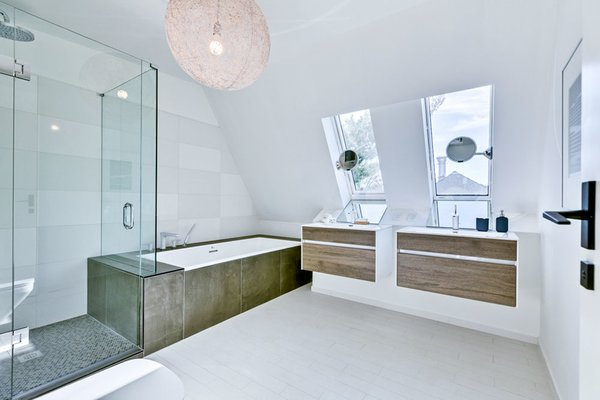 Modern home with bath room, ceramic tile floor, wall mount sink, drop in tub, engineered quartz counter, enclosed shower, pendant lighting, ceiling lighting, accent lighting, and ceramic tile wall. Photo 2 of 46H