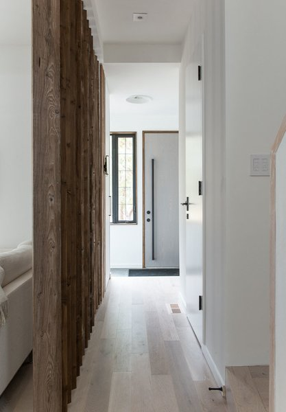 Modern home with hallway and light hardwood floor. Photo 8 of 46H