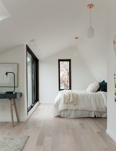 Modern home with bedroom, ceiling lighting, pendant lighting, bed, and light hardwood floor. Photo 15 of 46H