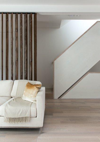 Modern home with living room, sofa, ceiling lighting, light hardwood floor, and pendant lighting. Photo 20 of 46H