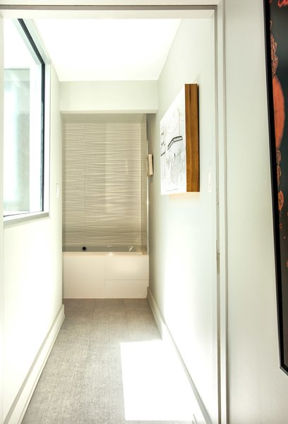 Window on left brings natural light into view of  master tub Photo 16 of Modern Building Approved in Jackson Ward-Historic district modern home