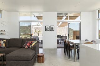 This Modern Homestead With a Vintage Trailer Offers Adventure in California's High Desert - Photo 5 of 10 - The living room of the main house has direct connections to the outdoors and the patio.